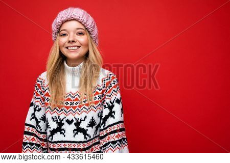 Attractive Smiling Happy Young Blonde Woman Standing Isolated Over Colorful Background Wall Wearing
