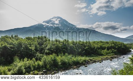 The Picturesque Vilyuchinsky Volcano With Snow-covered Slopes Against The Background Of Blue Sky And