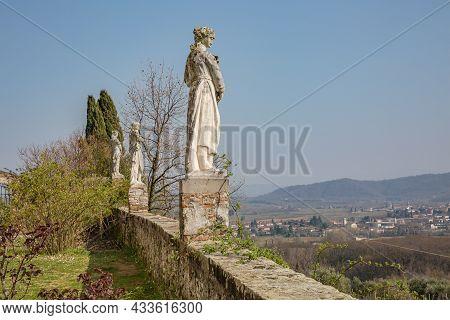 Landscape In The Collio Vineyard Area Of Friuli Venezia Giulia, North West Italy, Showing A Statue F