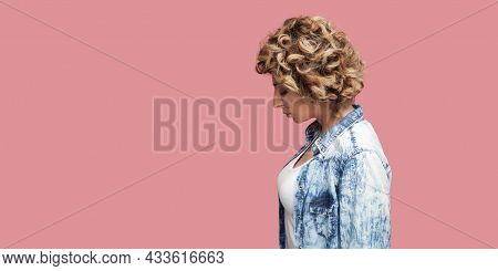 Thinking Sadness Or Confusion. Profile Side View Portrait Of Young Sad Woman With Blonde Curly Hairs