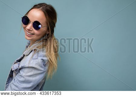 Attractive Happy Young Blonde Woman Wearing Everyday Stylish Clothes And Modern Sunglasses Isolated