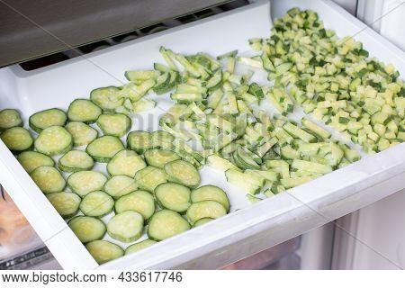 Frozen Green Cucumbers. Chopped Cucumbers In The Freezer. Frozen Food Concept.