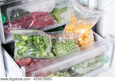 Frozen Food In The Freezer. Frozen Vegetables, Ready Meals In The Freezer. Frozen Meat, Food And Veg