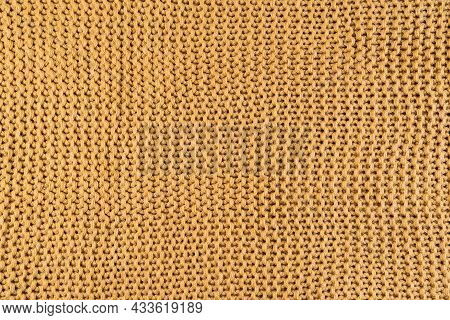 Close-up Of Gold Colored Knitted Fabric, Textile Background