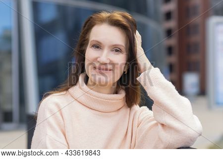 Portrait Of Smiling Pensive Middle Aged Woman. Elderly Businesswoman Near Business Center. Lecturer,