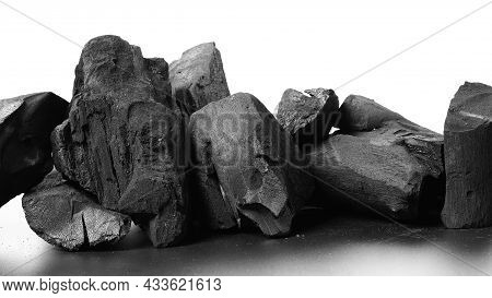 Wood Charcoal. Black Charcoal On Black Textured Floor. Used For Cooking