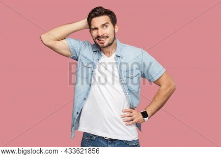 Portrait Of Query Handsome Bearded Young Man In Blue Casual Style Shirt Standing And Looking Away An