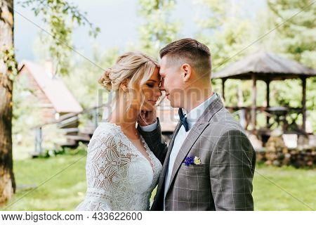 Portrait Of Young Couple In Love, Newlyweds Are Flirting With Each Other, Foreheads Are Touching, Gr