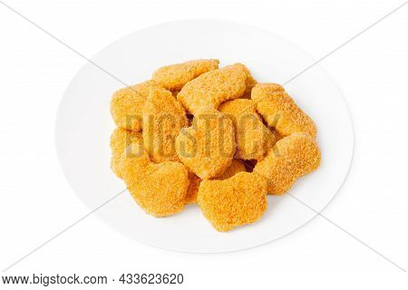 Chicken Breaded Nuggets On A White Plate.close-up Many Slices Of Breaded Inner Fillet, Sliced On A W