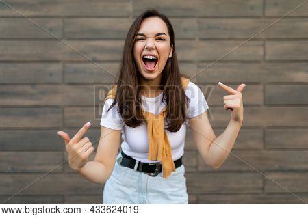 Portrait Of Young Happy Positive Beautiful Brunette Woman With Sincere Emotions Wearing Stylish Outf