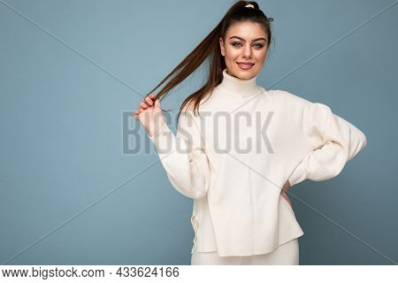 Photo Of Cute Nice Charming Gorgeous Pretty Youngster Smiling Toothily Wearing White Sweater Isolate