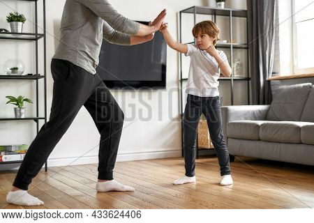 Active Small Teen Boy Child Workout Train With Father At Home On Weekend. Sporty Little Teenage Kid