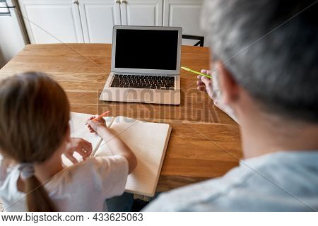 Back View Of Dad And Teen Girl Child Study Online On Computer Do Homework Together On Internet At Ho