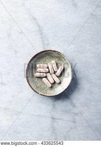 Carnitine Capsules. Concept For A Healthy Dietary Supplementation. Bright Stone Background. Soft Foc