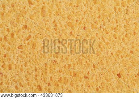 Macro Picture Of A Wet Yellow Sponge. Structure Of A Viscose Sponge, Top View Macro Texture. Sponge