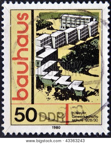stamp printed in GDR (East Germany) shows Bauhaus Architecture Trade-Union School