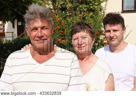 Portrait Of Caucasian Family Of Three. Father And Mother Are 62 Year Old, Senior People. Their Son I