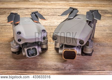 Fort Collins, CO, USA - July 4, 2021: Side by side comparison of two DJI prosumer folding drones - Mavic 2 pro and Mavic Air 2s.