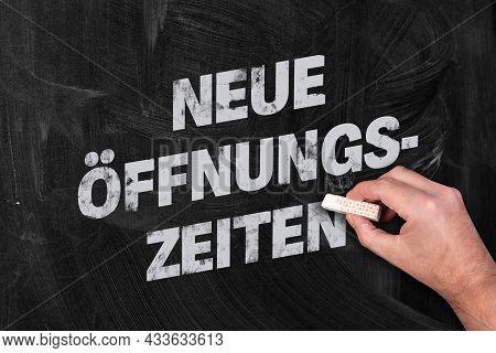 Text Neue Offnungszeiten, German For New Opening Hours, Written On Chalkboard
