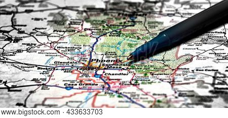 Closeup map of city Phoenix for travel destination driving with pen