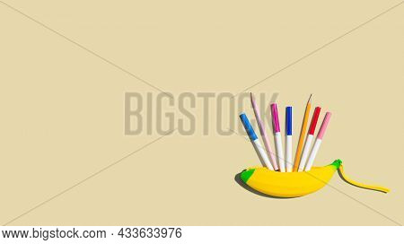 Banana Shaped Pen Case With Colorful Pens And Pencils