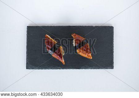 Japanese Sushi - Two Unagi Nigiri Sushi Served On A Black Stone Board. Eel Sushi. Sushi Pieces Serve