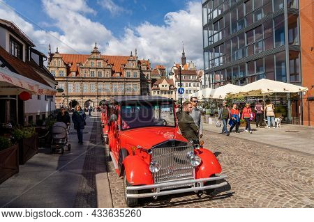 Tourist Guides And Taxis Wait For Business In Front Of The Green Gate In The Historic City Center Of