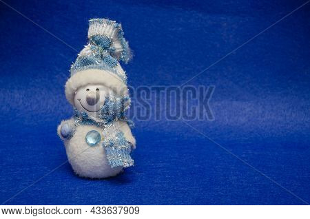 Christmas Card. Toy Snowman On Christmas Background.