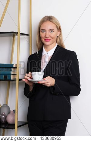 Woman Holding A White Cup With Tea Or Coffee In Her Hands. Coffee Break In The Office