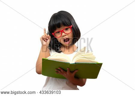 Happy Asian Little Preschool Girl Wearing Red Glasses Holding A Green Book And Thumbs Up On White Is