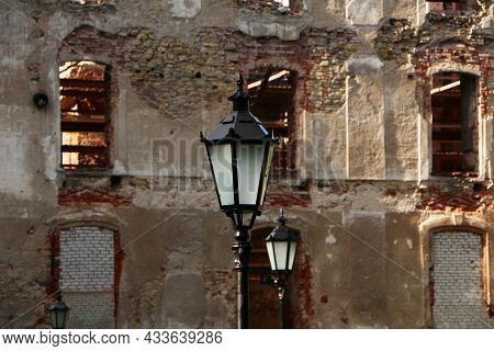 Old Lantern On The Background Of The Ancient Wall. Beautiful Background From An Ancient Lantern And