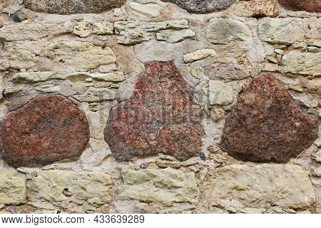 An Old Castle Wall Made Of Large Stones. Beautiful Background From An Old Wall Of The 16th Century.