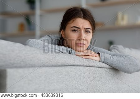 Pensive Upset Sad European Young Female Suffering From Depression Suffers From Loneliness And Self I