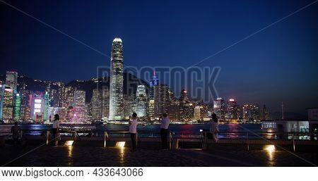 Victoria Harbor, Hong Kong 14 April 2021: Hong Kong city night