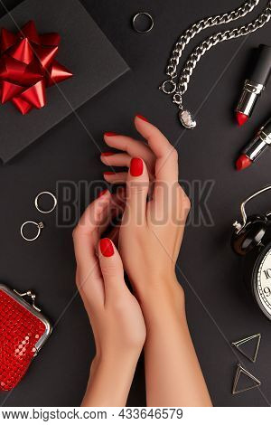 Manicured Womans Hands With Accessories On Black Background. Halloween Manicure, Pedicure Design Tre