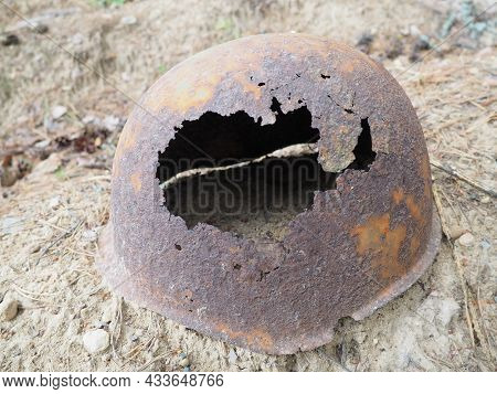 Authentic Second World War Helmet With Bullet Hole. Rusty Helmet On The Grave - Memorial In Orzega,