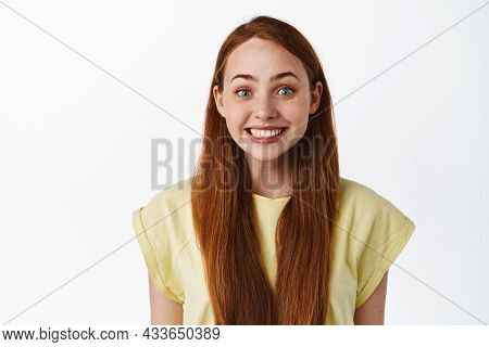 Close Up Of Cute Redhead Girl Smiling, Looking Hopeful And Happy, Anticipating Something, Glancing W