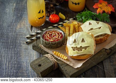 Halloween Party Food. Halloween Party Fun Ghost Burger, Ketup Sauce And  Potatoes Frie On A Wooden T