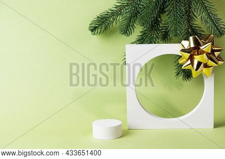Christmas Mock Up With White Podium On Green Background With Christmas Decor. Place For Christmas Pr
