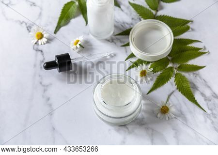 Daily Hygiene And Female Healthy Skincare. Cosmetic Cream And Skin Care Serum With Cammomile Flofers