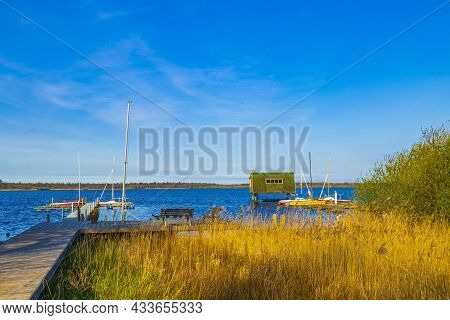 Bad Bederkesa Lake See Boats And Jetty On Sunny Day And Natural Landscape In Geestland Cuxhaven Lowe