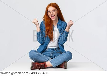 Cute And Confident Sassy Redhead Girl Won Challenge, Sit Floor, Fist Pump Saying Yes Celebrating Gre