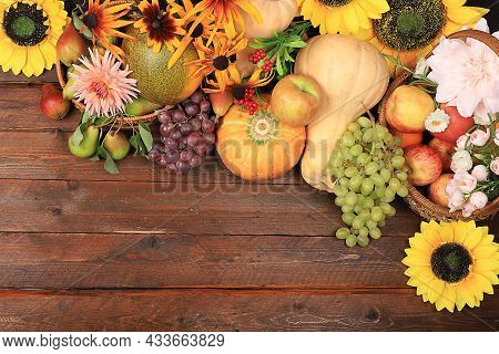 Autumn Background And Harvest In The Village With Seasonal Berries, Pumpkins, Apples, Rowan, Grapes