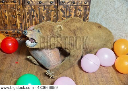 Skin Of A Bear In The Interior Of The Restaurant . Bear Skin In The Restaurant. The Bear Opens His M
