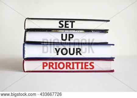 Set Up Your Priorities Symbol. Books With Words 'set Up Your Priorities'. Businessman Hand. Beautifu