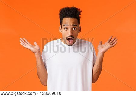 Waist-up Portrait Amazed, Surprised And Astonished Young Hipster Modern Man In White T-shirt, Shrugg