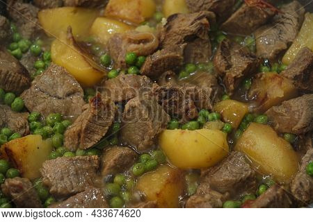 Tasty Slow Cooked Beef Meat Stew With Potatoes Close Up, Homemade Food Background