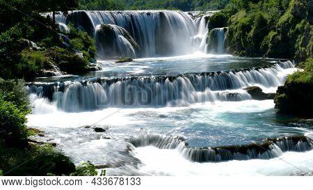 beautiful waterfall cascade in tropical rainforest