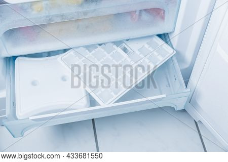 Ice cube make in modern freezer with no-frost, houseold concept