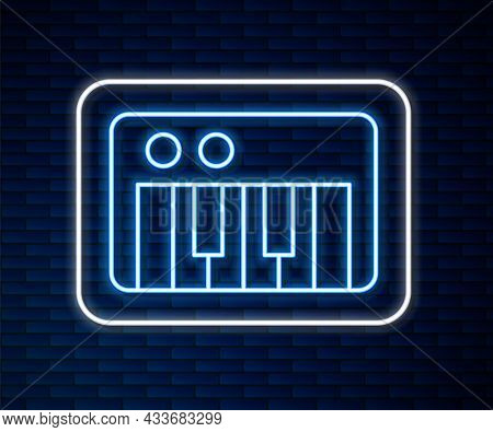 Glowing Neon Line Music Synthesizer Icon Isolated On Brick Wall Background. Electronic Piano. Vector